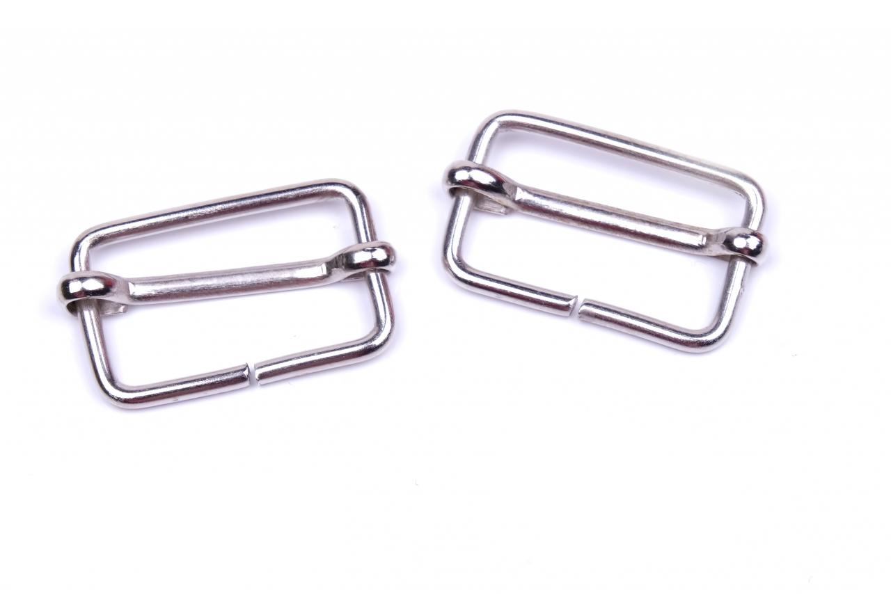 Posunovač kovový vnitřní průvlek 25mm nikl