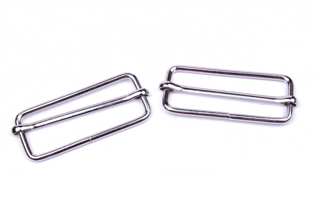 Posunovač kovový vnitřní průvlek 50mm nikl